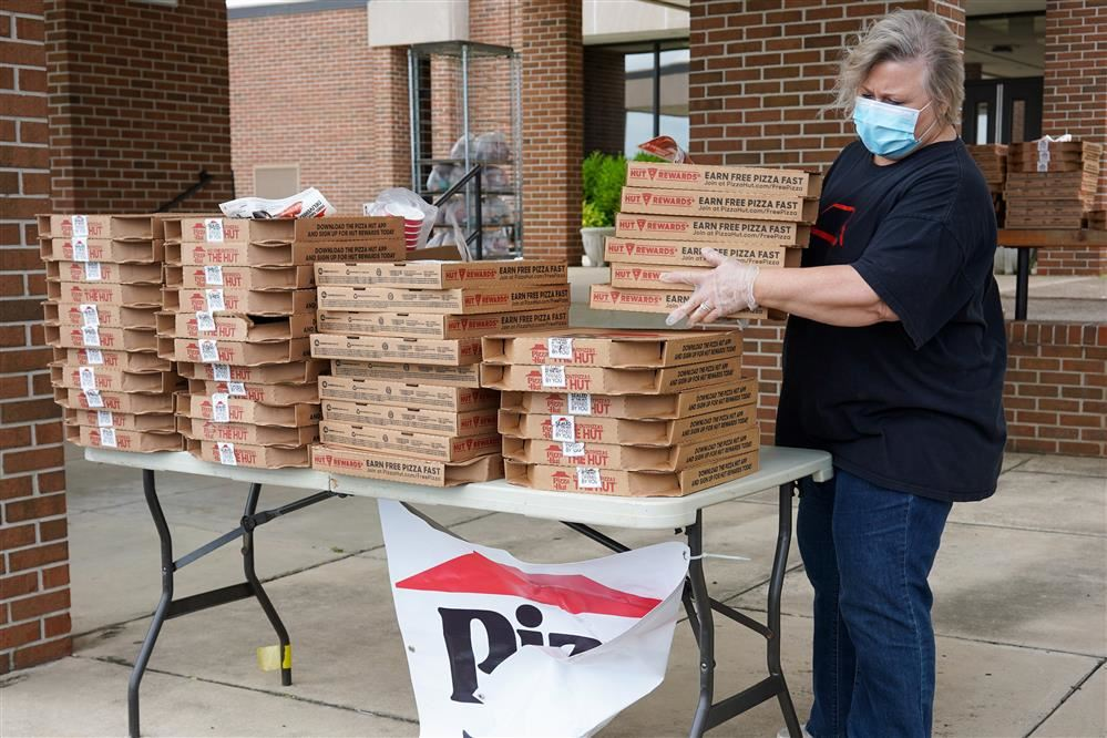 Michelle Mandley with Pizza Hut holds pizzas