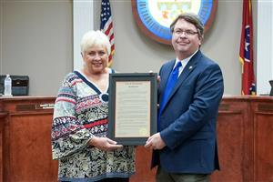 Dr. Wilson receives resolution from Mayor Whisenant