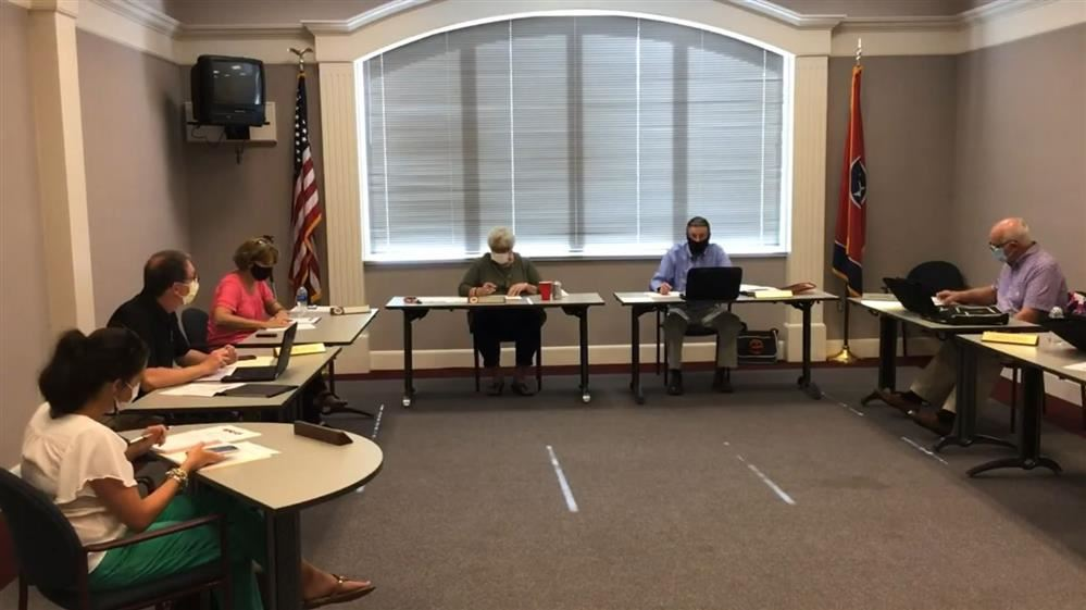 picture of school board members sitting around table