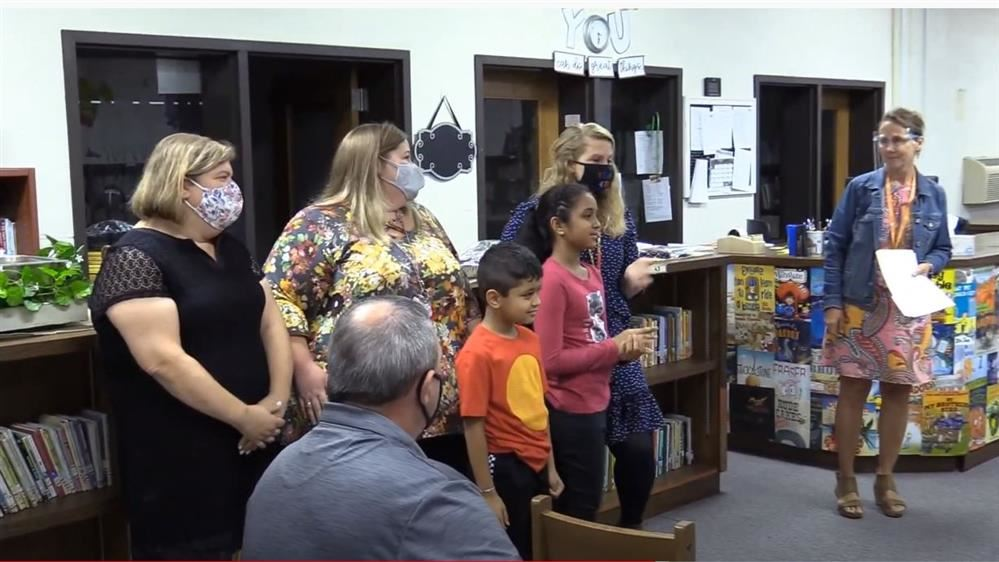 children at school board meeting