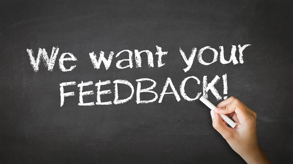 chalk board that reads we value your feedback