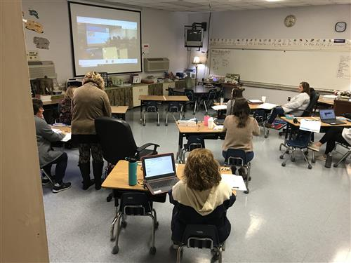 teachers watching screen